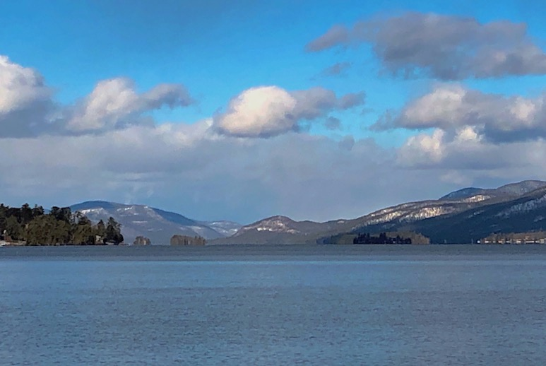 View of Lake George with snow on the mountains in the background