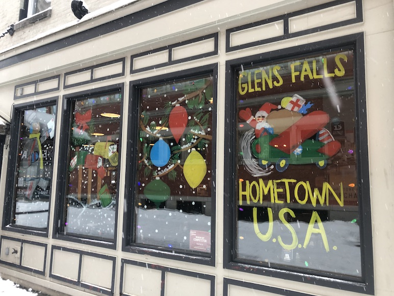 Restaurant storefront windows decorated for the Christmas season