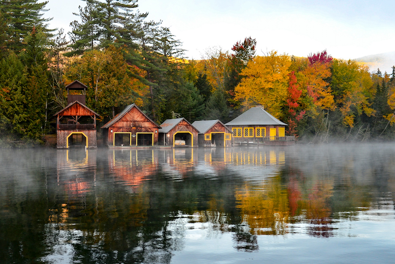 Boat Houses along a lake with mist over the water