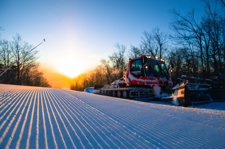 Snow grooming machine working on ski trails