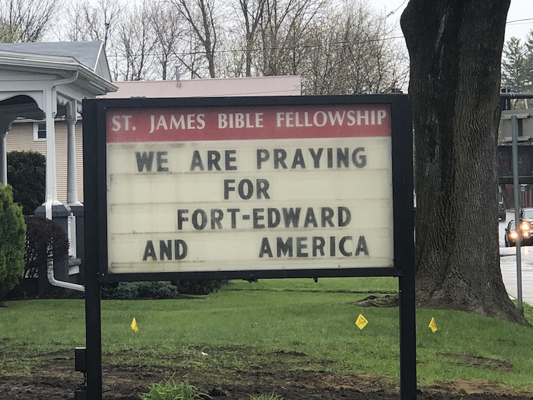 "Church sign reading ""We Are Praying for Fort Edward And America"""