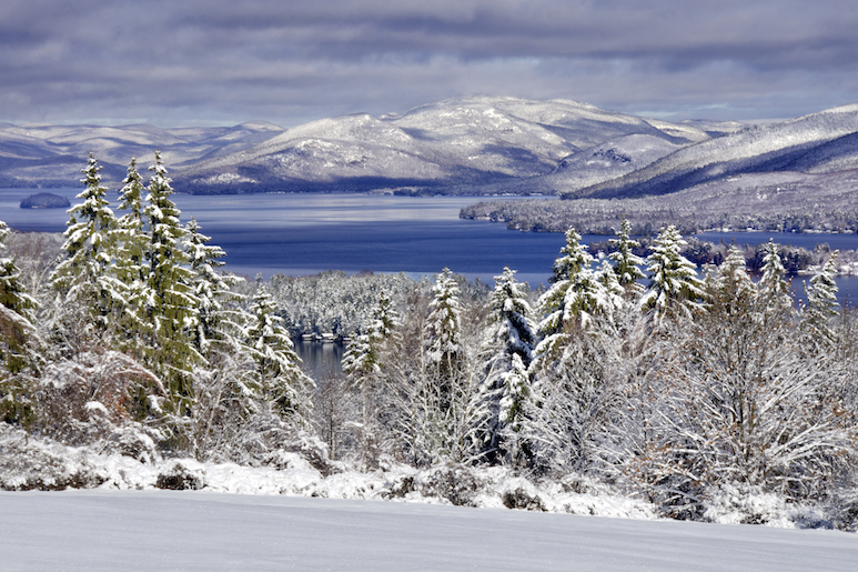 Winter view of Lake George with snow on the surrounding mountains