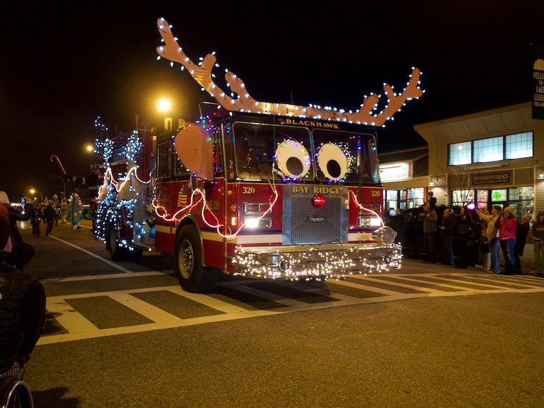 Firetruck decorated as a reindeer at a Christmas parade